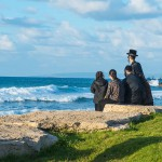 Jewish family overlooking Mediterranean Sea in Israel.
