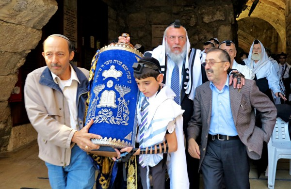 Jewish father and son, Western (Wailing) Wall, Jerusalem, carrying Torah scroll